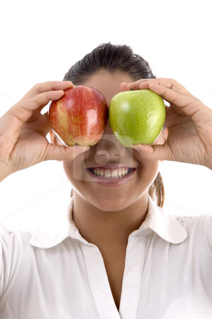 Woman posing with apples  stock photo, Woman posing with apples on an isolated background by Imagery Majestic