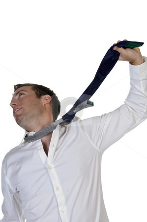Businessman hanging himself to his tie stock photo, Businessman hanging himself to his tie with white background by Imagery Majestic