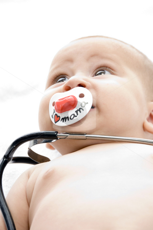 Cheerful child with stethoscope stock photo, Cheerful child with stethoscope with white background by Imagery Majestic