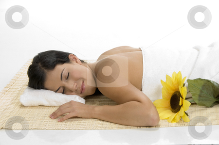 Female sleeping on mat with sunflower stock photo, Female sleeping on mat with sunflower by Imagery Majestic