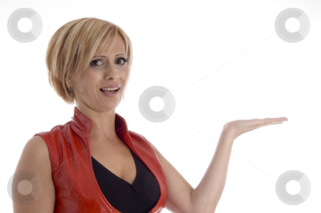 Smiling woman showing palm stock photo, Smiling woman showing palm on an isolated background by Imagery Majestic