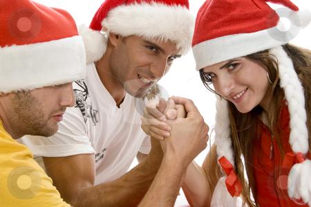 Models doing arm wrestling stock photo, Models doing arm wrestling against white background by Imagery Majestic