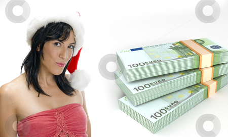 Three dimensional currency bundles stack and woman with santa hat  stock photo, Three dimensional currency bundles stack and woman with santa hat on an isolated white background by Imagery Majestic