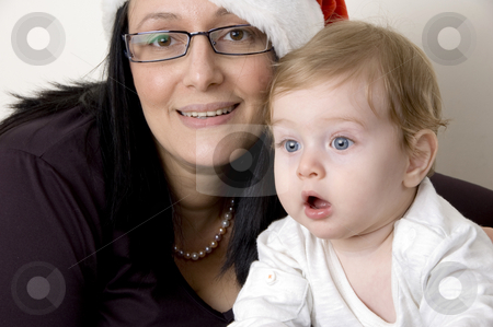 Portrait of mother and child stock photo, Portrait of pleased mother and cute child by Imagery Majestic
