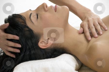 Sexy female taking massage stock photo, Sexy female taking massage on an isolated background by Imagery Majestic