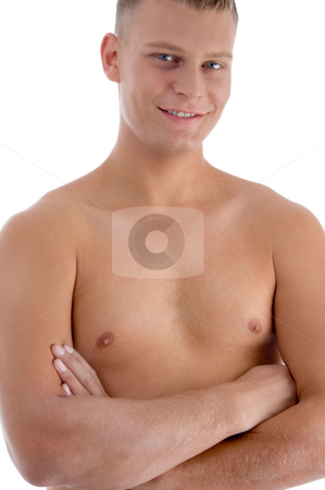 Smiling muscular man with crossed arms stock photo, Smiling muscular man with crossed arms against white background by Imagery Majestic
