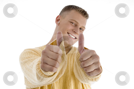 Handsome man showing good luck sign with both hands stock photo, Handsome man showing good luck sign with both hands on an isolated white background by Imagery Majestic