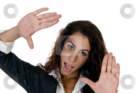 Young lady showing hand gesture stock photo, Young lady showing hand gesture against white background by Imagery Majestic