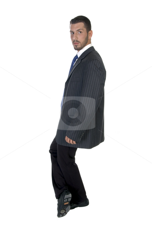 Stylish pose of successful businessman stock photo, Stylish pose of successful businessman on an isolated white background by Imagery Majestic