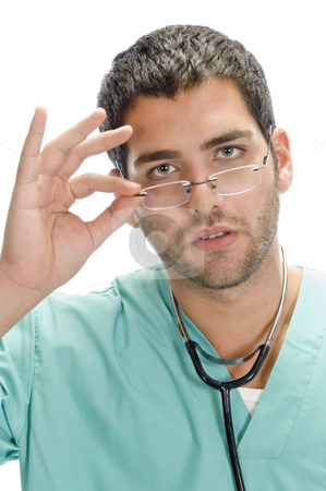 Doctor holding spectacles stock photo, Doctor holding spectacles with white background by Imagery Majestic