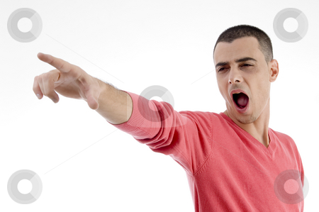 Shouting man pointing side stock photo, Shouting man pointing side on an isolated background by Imagery Majestic