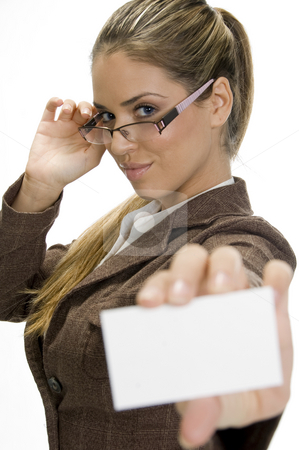 Successful businesswoman posing with visiting card stock photo, Successful businesswoman posing with visiting card and holding her eyewear by Imagery Majestic