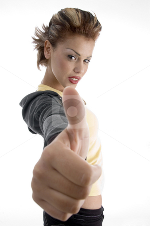 Glamorous woman showing good luck sign stock photo, Glamorous woman showing good luck sign with white background by Imagery Majestic
