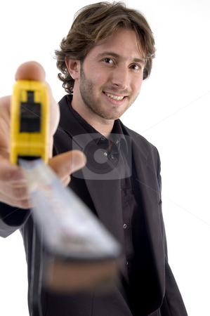 Male showing measuring tape stock photo, Male showing measuring tape on an isolated white background by Imagery Majestic