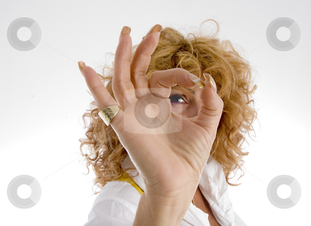 Woman showing ok sign stock photo, Woman showing ok sign on an isolated background by Imagery Majestic