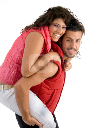 Woman riding piggy back on man stock photo, Woman riding piggy back on man on an isolated background by Imagery Majestic