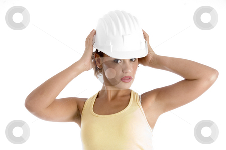Woman with architect helmet stock photo, Woman with architect helmet against white background by Imagery Majestic