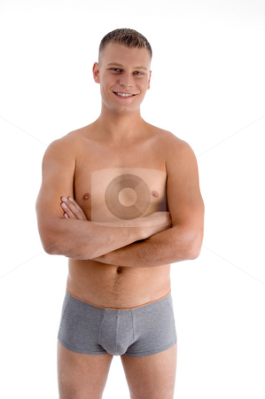 Muscular man with crossed arms stock photo, Muscular man with crossed arms with white background by Imagery Majestic