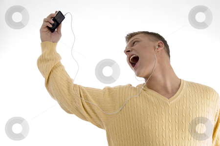 Man enjoying music with ipod stock photo, Man enjoying music with ipod on an isolated background by Imagery Majestic