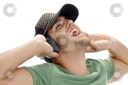 Happy man enjoying music stock photo, Happy man enjoying music on an isolated white background by Imagery Majestic