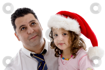 Girl wearing christmas hat posing with her father stock photo, Little girl wearing christmas hat posing with her father by Imagery Majestic