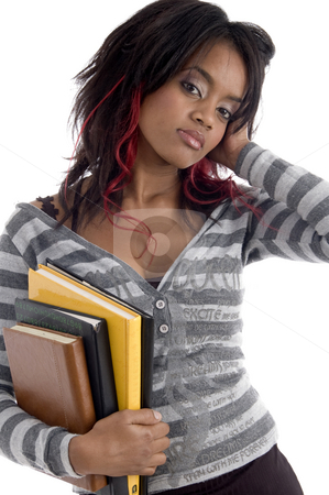 Girl with books stock photo, Girl with books on an isolated background by Imagery Majestic