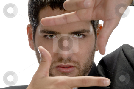 Man showing framing hand gesture stock photo, Man showing framing hand gesture on an isolated background by Imagery Majestic