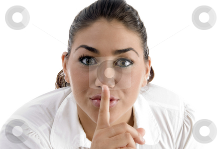 Woman instructing to be silent stock photo, Woman instructing to be silent on an isolated background by Imagery Majestic