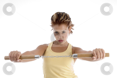 Woman with nunchaku stock photo, Woman with nunchaku with white background by Imagery Majestic