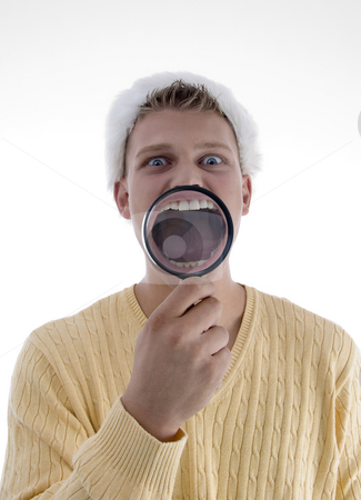 Man weaing santa hat and showing teeth through lens  stock photo, Man weaing santa hat and showing teeth through lens on an isolated background by Imagery Majestic