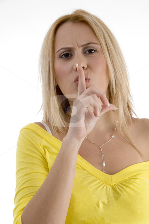 Sexy woman instructing you to keep silent stock photo, Sexy woman instructing you to keep silent on an isolated background by Imagery Majestic
