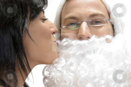 Woman kissing to santa man stock photo, Woman kissing to santa man against white background by Imagery Majestic