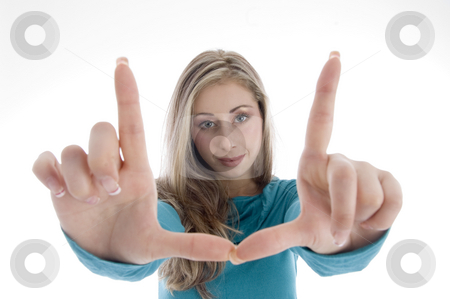 Woman showing directing hand gesture stock photo, Woman showing directing hand gesture with white background by Imagery Majestic