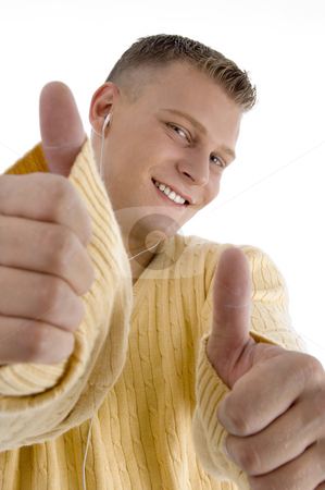 Smiling guy showing good luck sign with both hands stock photo, Smiling guy showing good luck sign with both hands on an isolated background by Imagery Majestic