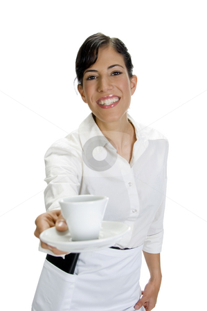 Smiling waitress serving coffee stock photo, Smiling waitress serving coffee on an isolated background by Imagery Majestic