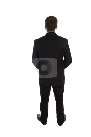 Standing businessman posing from back stock photo, Standing businessman posing from back on an isolated white background by Imagery Majestic