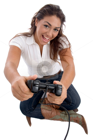 Young cute girl playing video game stock photo, Young cute girl playing video game on an isolated white background by Imagery Majestic