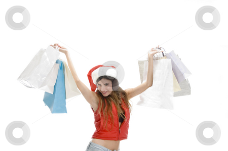Happy woman showing shopping bags stock photo, Happy woman showing shopping bags with white background by Imagery Majestic