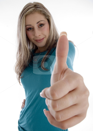 Smiling woman showing approval sign stock photo, Smiling woman showing approval sign on an isolated white background by Imagery Majestic