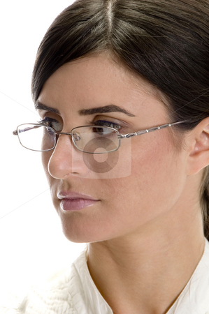Close up lady looking side stock photo, Close up lady looking side on an isolated background by Imagery Majestic