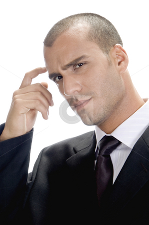 Handsome man thinking stock photo, Handsome man thinking against white background by Imagery Majestic