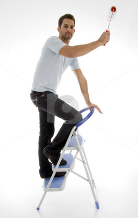 Young man painting stock photo, Young man painting on an isolated white backgound by Imagery Majestic