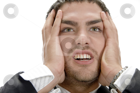 Frustrated young businessman stock photo, Frustrated young businessman on an isolated background by Imagery Majestic