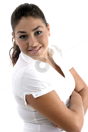 Smiling beautiful model with crossed arms stock photo, Smiling beautiful model with crossed arms on an isolated white background by Imagery Majestic