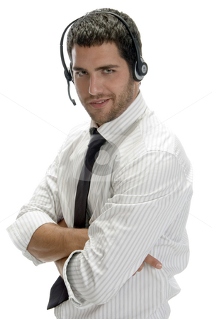 Happy successful professional man with headset stock photo, Happy successful professional man with headset on an isolated white background by Imagery Majestic