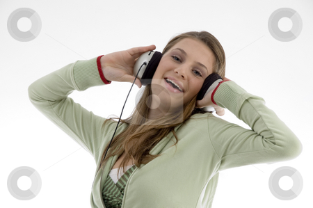 Attractive female enjoying music stock photo, Attractive female enjoying music isolated with white background by Imagery Majestic