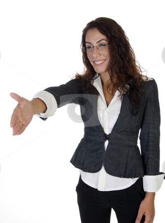 Cheerful woman offering hand shake stock photo, Cheerful woman offering hand shake on an isolated background by Imagery Majestic