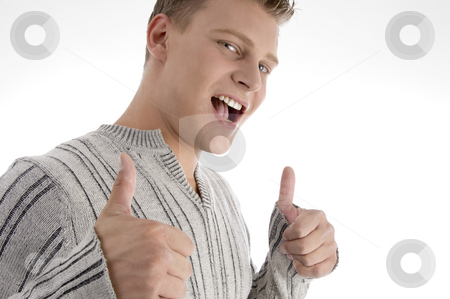 Handsome man showing thumbs up stock photo, Handsome man showing thumbs up on an isolated background by Imagery Majestic
