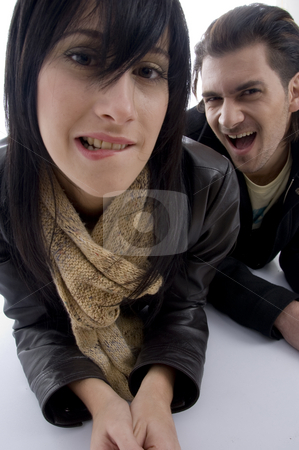 Playful couple lying on floor stock photo, Playful couple lying on floor against white background by Imagery Majestic