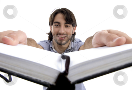 Smart guy holding his opened diary stock photo, Smart guy holding his opened diary isolated on white background by Imagery Majestic